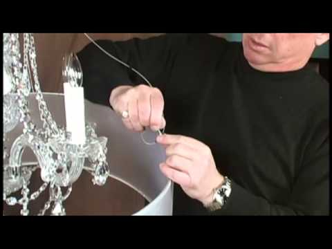 Showing how to update a chandelier with shades with the clip and slide attachment and drum shade
