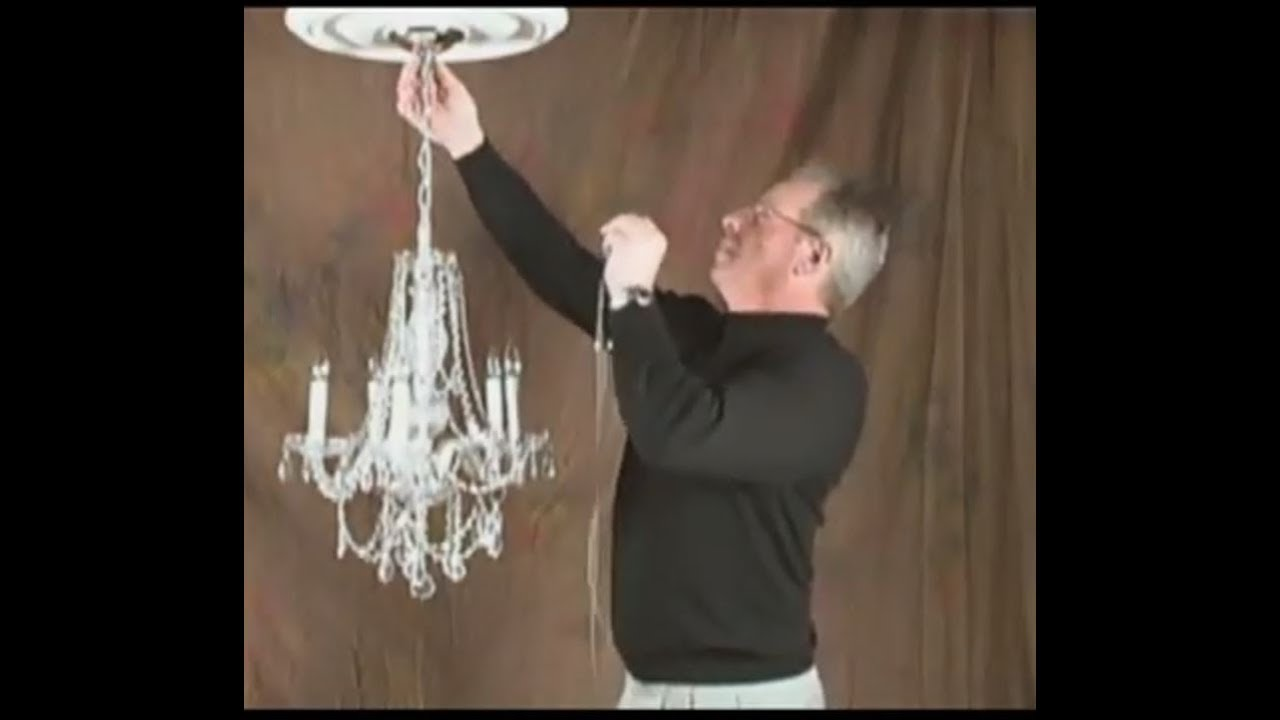 Demonstrating how to update a chandelier with shades sheer magic clip and slide shade attachment