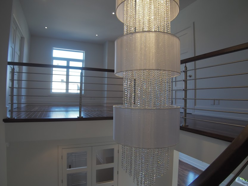Large customized crystal ceiling light. Crystal Rain foyer fixture with 3 silver drum shades and crystal strand adder.